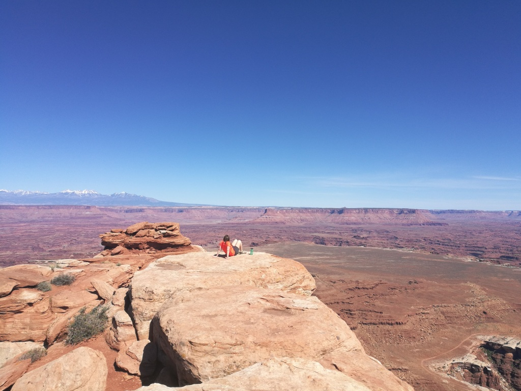 Anna sitting down at the White Rim Overlook
