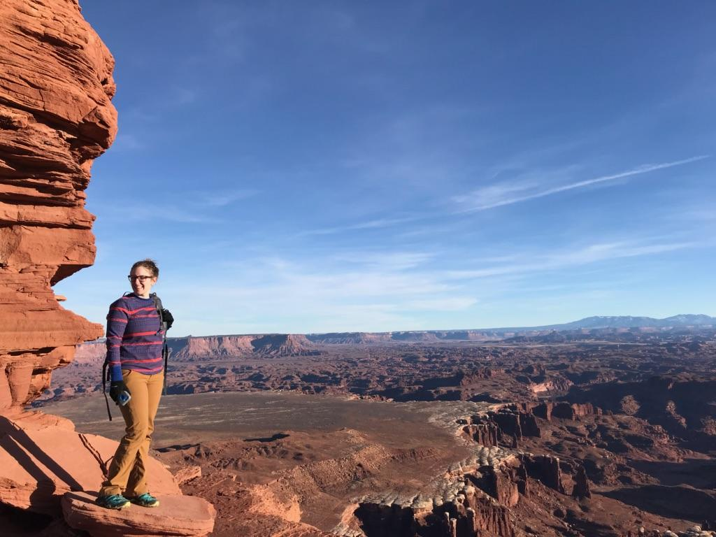 Anna standing at the White Rim Overlook in Canyonlands National Park.