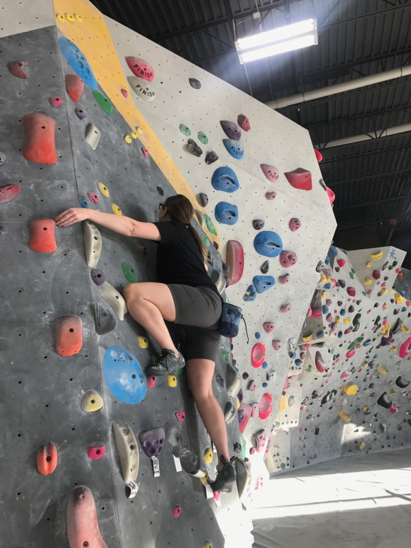 Anna Wendt climbs a V2 at Momentum in Lehi, Utah.