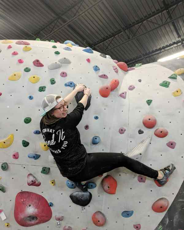 Anna Wendt climbs a V4 at Momentum in Lehi, Utah.