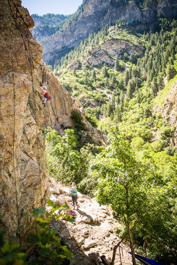 Anna climbing in Rock Canyon in Provo Utah while a friend belays from below.