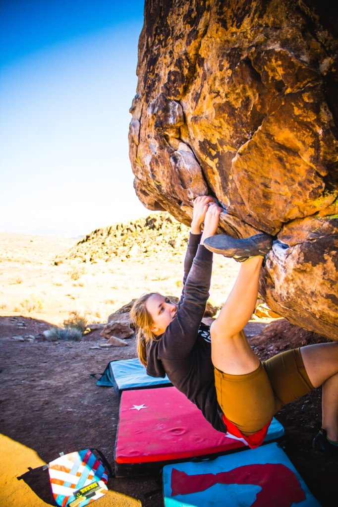 Anna bouldering in Moe's Valley in St. George, Utah on Jabberwock Arete.
